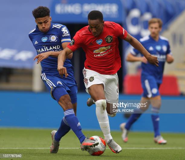 Leicester City's English defender James Justin wins the ball cleanly from Manchester United's French striker Anthony Martial after Martial ran...