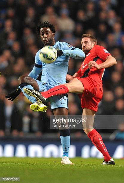 Leicester City's English defender Matthew Upson vies with Manchester City's Ivorian striker Wilfried Bony during the English Premier League football...