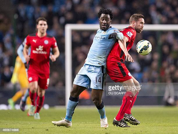 Leicester City's English defender Matthew Upson vies with Manchester City's Ivorian forward Wilfried Bony during the English Premier League football...
