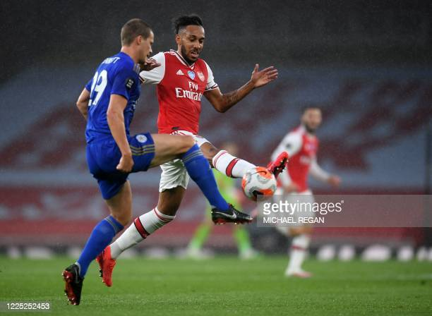 Leicester City's English defender Ryan Bennett challenges Arsenal's Gabonese striker Pierre-Emerick Aubameyang during the English Premier League...