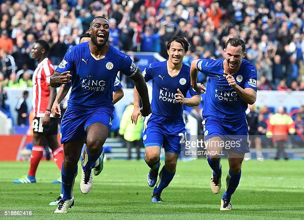 Leicester City's English defender Wes Morgan celebrates after scoring during the English Premier League football match between Leicester City and...