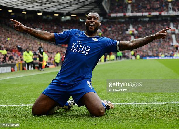 Leicester City's English defender Wes Morgan celebrates scoring the equalising 11 goal during the English Premier League football match between...