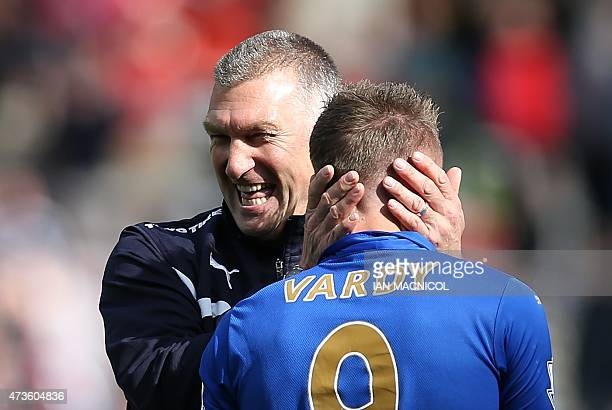 Leicester City's English manager Nigel Pearson celebrates with Leicester City's English striker Jamie Vardy celebrate at full time in the English...