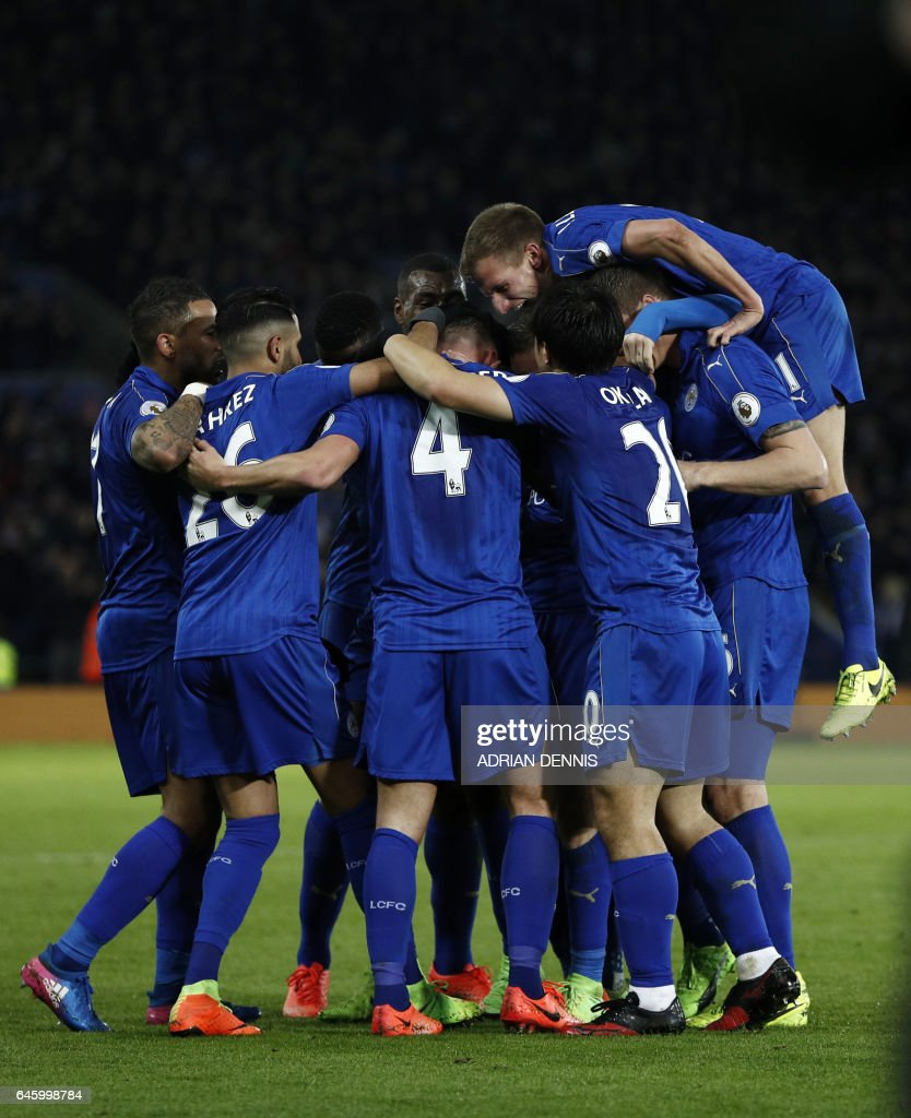 Leicester City's English midfielder Danny Drinkwater (C) celebrates with teammates after scoring his team's second goal during the English Premier League football match between Leicester City and Liverpool at King Power Stadium in Leicester, central England on February 27, 2017. / AFP / ADRIAN DENNIS / RESTRICTED TO EDITORIAL USE. No use with unauthorized audio, video, data, fixture lists, club/league logos or 'live' services. Online in-match use limited to 75 images, no video emulation. No use in betting, games or single club/league/player publications. /