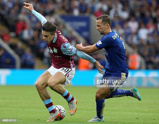 Leicester City's English midfielder Danny Drinkwater vies with Aston Villa's English midfielder Jack Grealish during the English Premier League...
