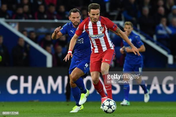 Leicester City's English midfielder Danny Drinkwater vies with Atletico Madrid's Spanish midfielder Saul Niguez during the UEFA Champions League...