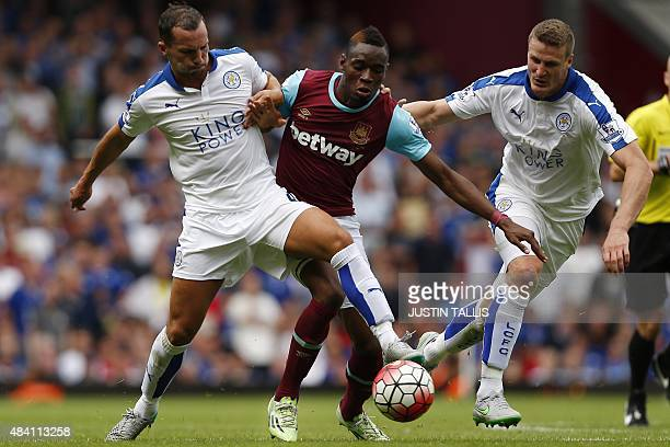 Leicester City's English midfielder Danny Drinkwater West Ham United's Senegalese striker Diafra Sakho and Leicester City's German defender Robert...