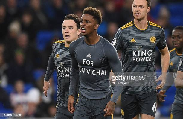 Leicester City's English midfielder Demarai Gray reveals his under shirt which reads 'For Vichai' as he celebrates scoring the opening goal during...