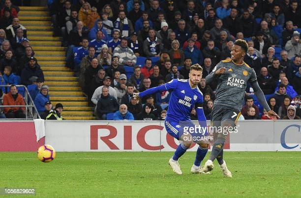 Leicester City's English midfielder Demarai Gray scores the opening goal during the English Premier League football match between between Cardiff...