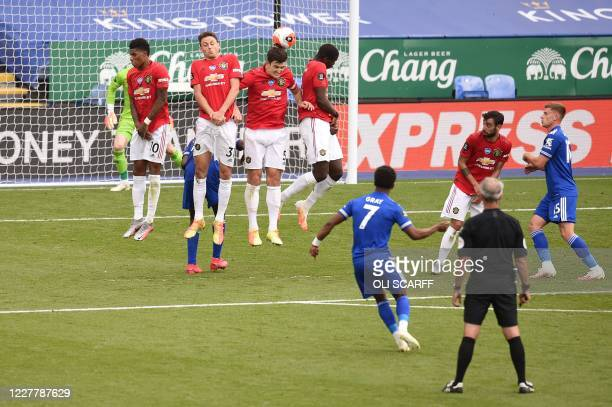 Leicester City's English midfielder Demarai Gray sends a free kick over the defensive wall and over the bar during the English Premier League...