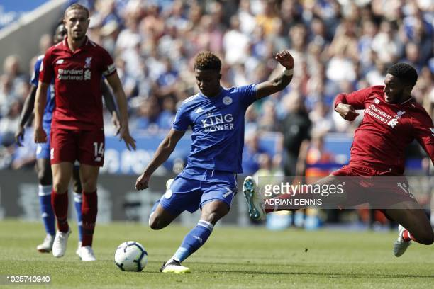 Leicester City's English midfielder Demarai Gray vies with Liverpool's English defender Joe Gomez during the English Premier League football match...