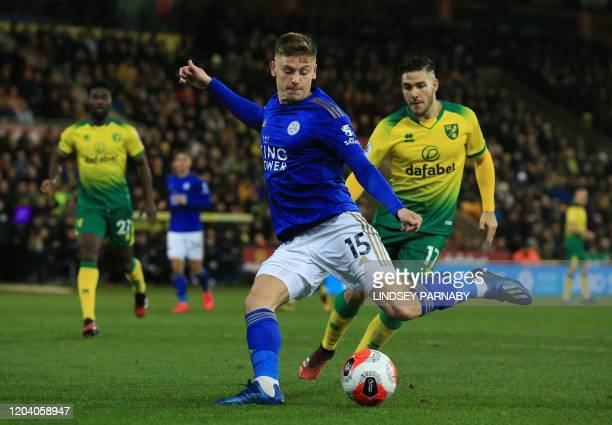 Leicester City's English midfielder Harvey Barnes has a shot in front of Norwich City's Argentinian midfielder Emiliano Buendía during the English...