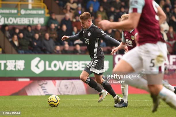 Leicester City's English midfielder Harvey Barnes runs with the ball to score the opening goal during the English Premier League football match...