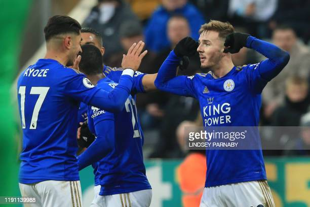 Leicester City's English midfielder James Maddison celebrates after scoring their second goal with Leicester City's Spanish striker Ayoze Perez...