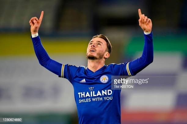 Leicester City's English midfielder James Maddison celebrates after scoring the opening goal of the English Premier League football match between...