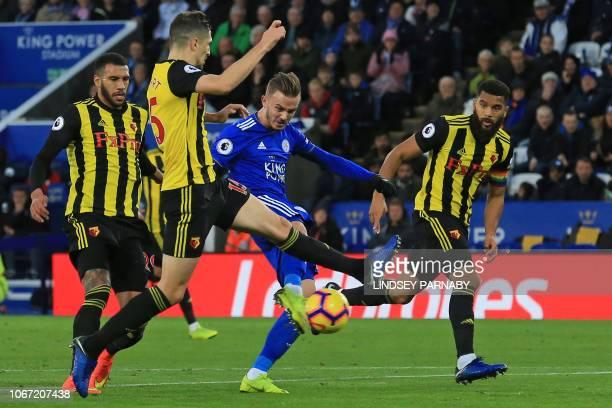 Leicester City's English midfielder James Maddison challenged by Watford's French midfielder Etienne Capoue Watford's Northern Irish defender Craig...