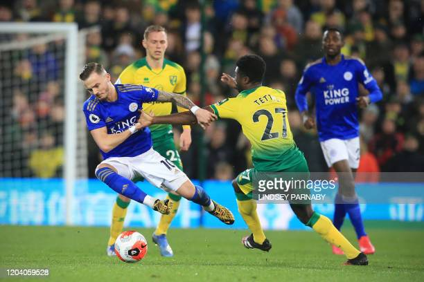 Leicester City's English midfielder James Maddison is tackled by Norwich City's Ghanaian-born Norwegian midfielder Alexander Tettey during the...