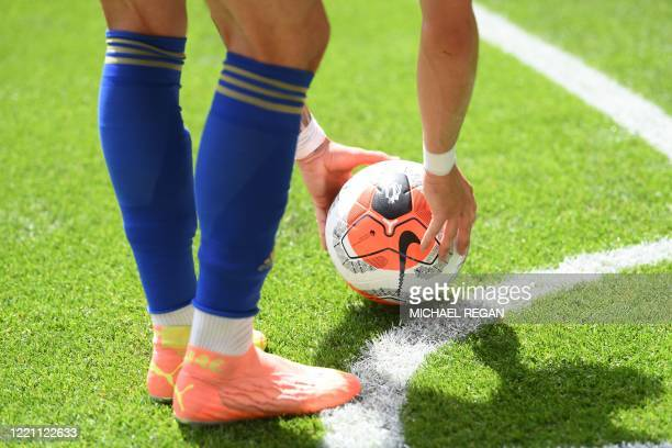 Leicester City's English midfielder James Maddison places the ball for a corner kick during the English Premier League football match between Watford...