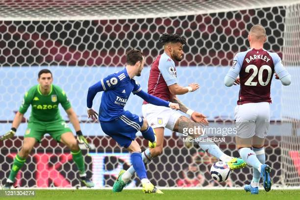 Leicester City's English midfielder James Maddison shoots to score the opening goal of the English Premier League football match between Aston Villa...