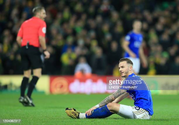 Leicester City's English midfielder James Maddison sits on the pitch during the English Premier League football match between Norwich City and...
