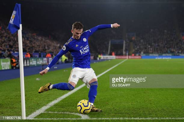 Leicester City's English midfielder James Maddison takes a corner kick during the English Premier League football match between Leicester City and...
