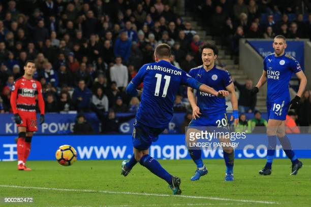 Leicester City's English midfielder Marc Albrighton scores the team's third goal during the English Premier League football match between Leicester...