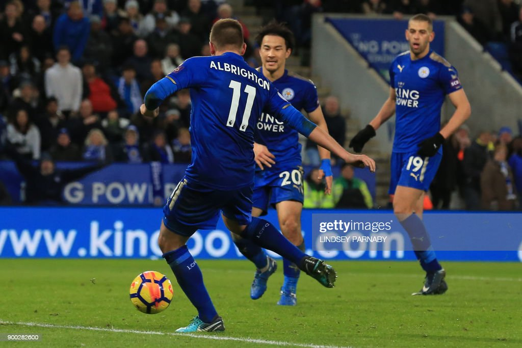 Leicester City's English midfielder Marc Albrighton (L) scores the team's third goal during the English Premier League football match between Leicester City and Huddersfield Town at King Power Stadium in Leicester, central England on January 1, 2018. / AFP PHOTO / Lindsey PARNABY / RESTRICTED TO EDITORIAL USE. No use with unauthorized audio, video, data, fixture lists, club/league logos or 'live' services. Online in-match use limited to 75 images, no video emulation. No use in betting, games or single club/league/player publications. /