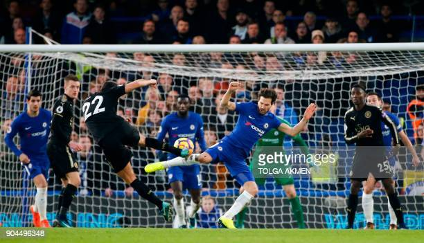 Leicester City's English midfielder Matty James and Chelsea's Spanish midfielder Cesc Fabregas go for the ball during the English Premier League...