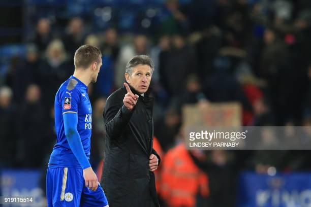 Leicester City's English striker Jamie Vardy and Leicester City's French manager Claude Puel interact after the English FA Cup fifth round football...
