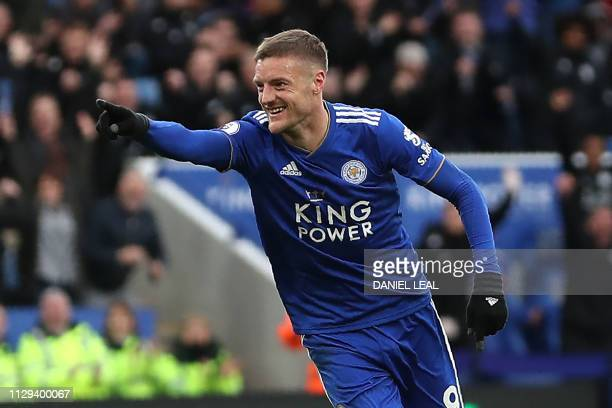 Leicester City's English striker Jamie Vardy celebrates after scoring their third goal during the English Premier League football match between...
