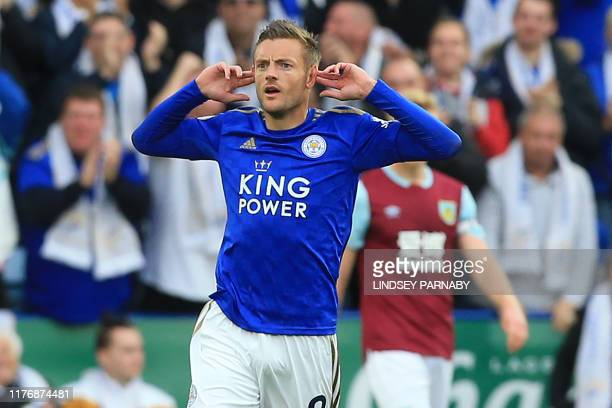 Leicester City's English striker Jamie Vardy celebrates after scoring their first goal during the English Premier League football match between...