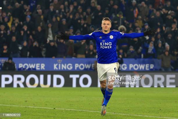 Leicester City's English striker Jamie Vardy celebrates after scoring the opening goal from the penalty spot during the English Premier League...