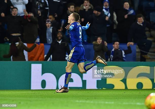 Leicester City's English striker Jamie Vardy celebrates after scoring the opening goal of the English Premier League football match between Leicester...