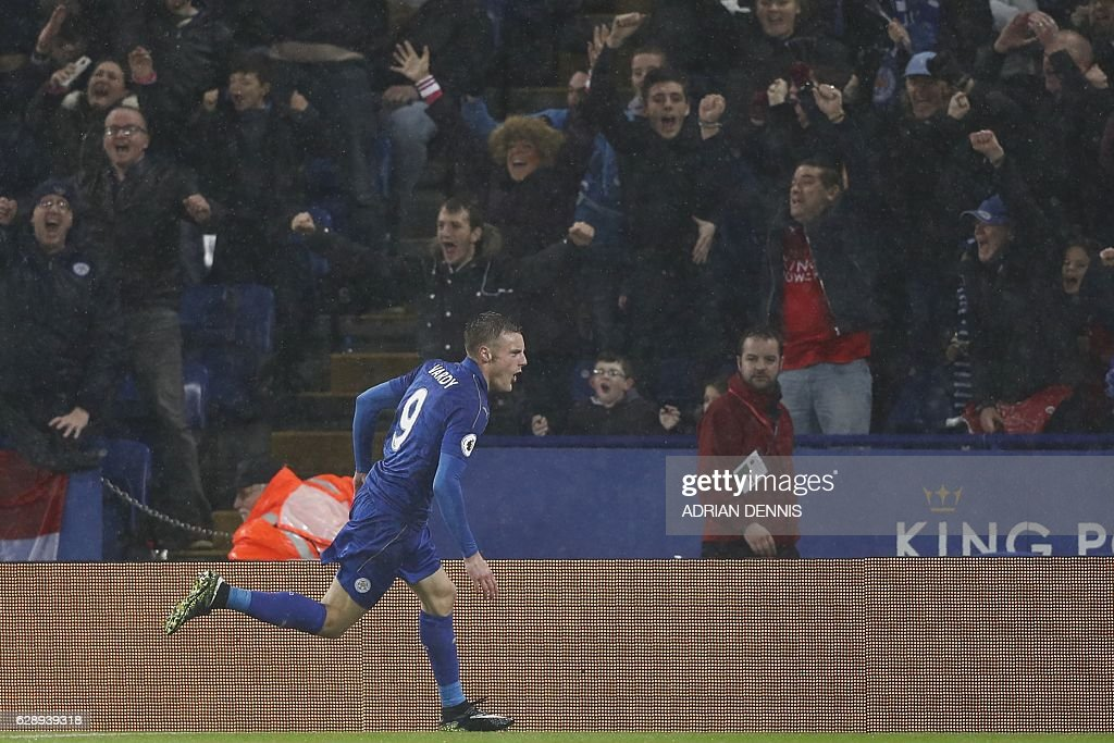Leicester City's English striker Jamie Vardy celebrates after scoring their third goal during the English Premier League football match between Leicester City and Manchester City at King Power Stadium in Leicester, central England on December 10, 2016. / AFP / Adrian DENNIS / RESTRICTED TO EDITORIAL USE. No use with unauthorized audio, video, data, fixture lists, club/league logos or 'live' services. Online in-match use limited to 75 images, no video emulation. No use in betting, games or single club/league/player publications. /