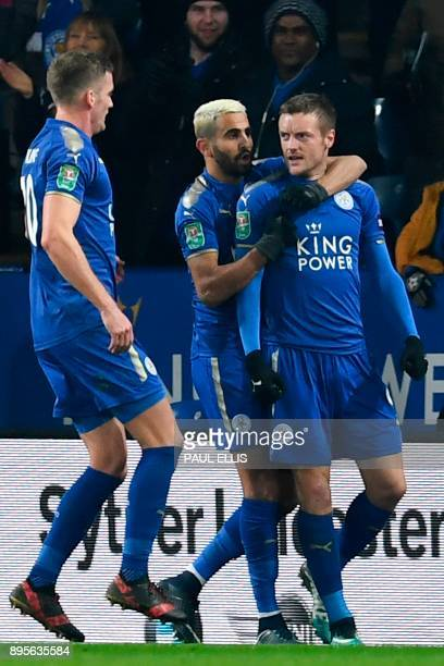 Leicester City's English striker Jamie Vardy celebrates scoring an equalising goal from the penalty spot to make the score 11 with Leicester City's...