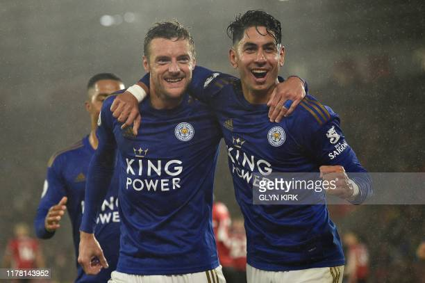 Leicester City's English striker Jamie Vardy celebrates scoring his team's fifth goal with Leicester City's Spanish striker Ayoze Perez during the...