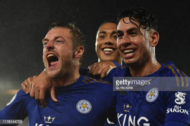 Leicester City's English striker Jamie Vardy celebrates scoring his team's fifth goal with Leicester City's Belgian midfielder Youri Tielemans and...