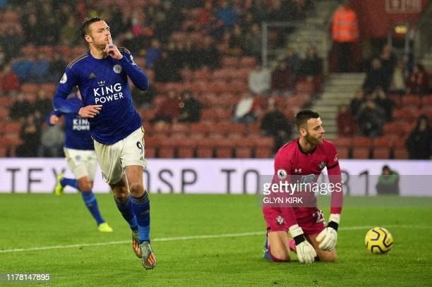 Leicester City's English striker Jamie Vardy celebrates scoring his team's ninth goal from the penalty spot during the English Premier League...