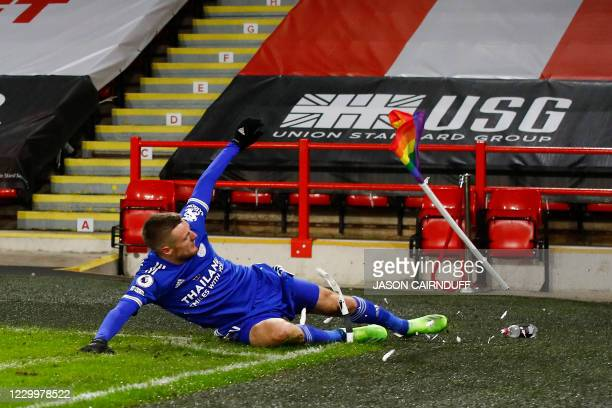 Leicester City's English striker Jamie Vardy celebrates scoring his team's second goal by sliding into the corner flag during the English Premier...