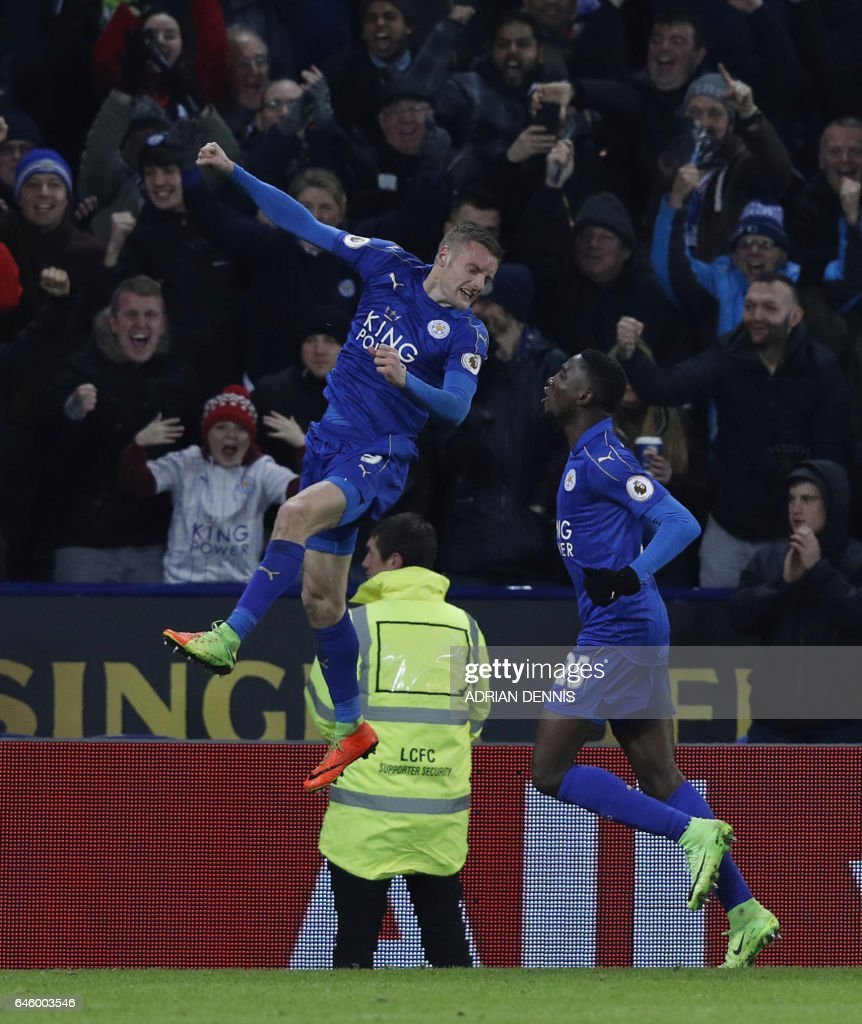 Leicester City's English striker Jamie Vardy (L) celebrates scoring his team's third goal with Leicester City's Nigerian midfielder Wilfred Ndidi during the English Premier League football match between Leicester City and Liverpool at King Power Stadium in Leicester, central England on February 27, 2017. / AFP / ADRIAN DENNIS / RESTRICTED TO EDITORIAL USE. No use with unauthorized audio, video, data, fixture lists, club/league logos or 'live' services. Online in-match use limited to 75 images, no video emulation. No use in betting, games or single club/league/player publications. /