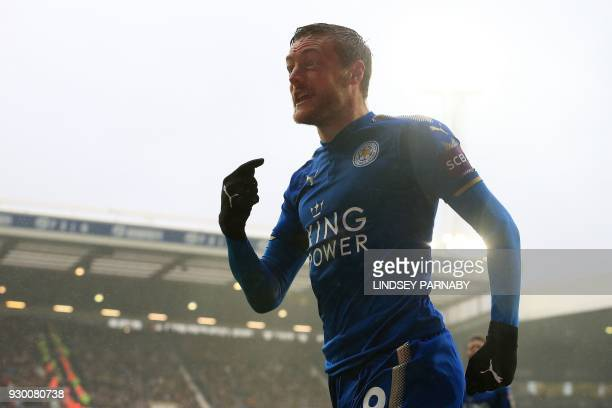 Leicester City's English striker Jamie Vardy celebrates scoring his team's first goal during the English Premier League football match between West...