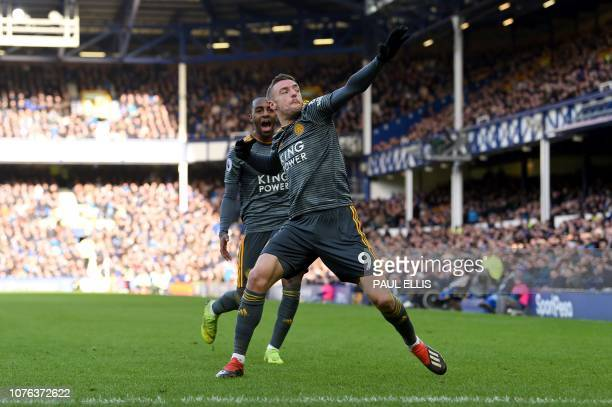 Leicester City's English striker Jamie Vardy celebrates scoring the opening goal during the English Premier League football match between Everton and...