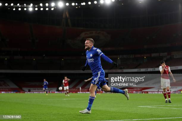 Leicester City's English striker Jamie Vardy celebrates scoring the opening goal during the English Premier League football match between Arsenal and...
