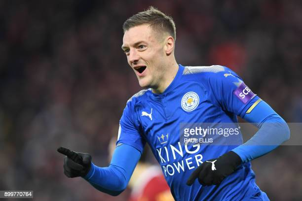 Leicester City's English striker Jamie Vardy celebrates scoring the team's first goal during the English Premier League football match between...