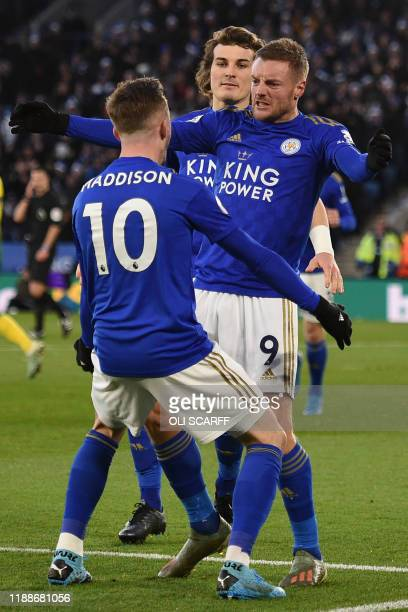 Leicester City's English striker Jamie Vardy celebrates with Leicester City's English midfielder James Maddison and Leicester City's Turkish defender...