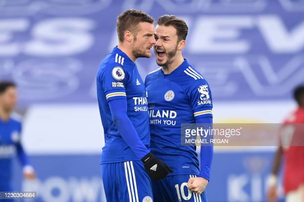 Leicester City's English striker Jamie Vardy celebrates with Leicester City's English midfielder James Maddison after scoring their second goal...