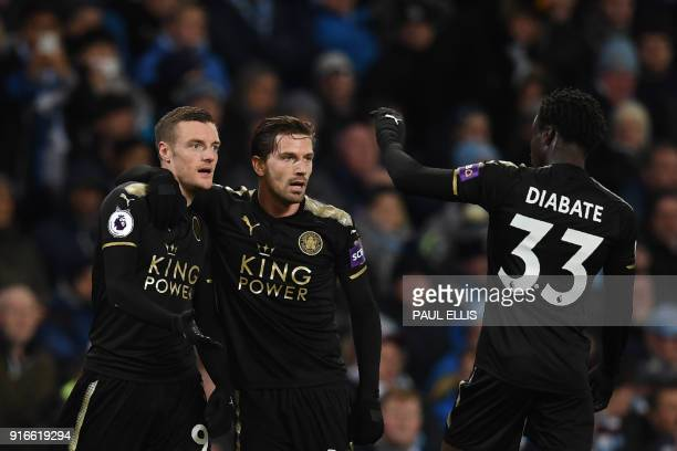 Leicester City's English striker Jamie Vardy celebrates with Leicester City's Portuguese midfielder Adrien Silva and Leicester City's Malian...