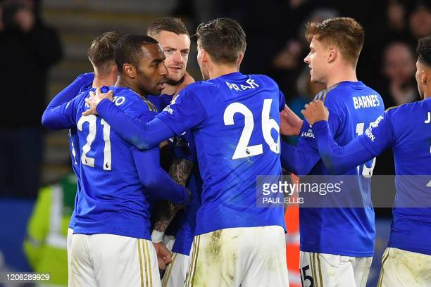 Leicester City's English striker Jamie Vardy celebrates with teammates after scoring their second goal from the penalty spot during the English...