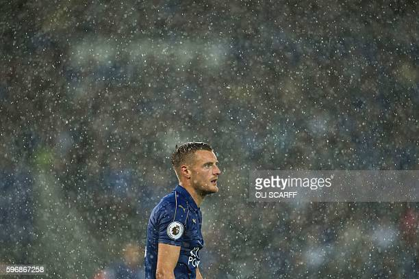 Leicester City's English striker Jamie Vardy in the rain during the English Premier League football match between Leicester City and Swansea City at...