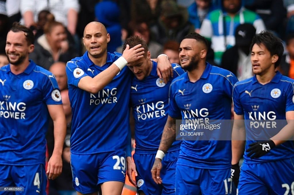 Leicester City's English striker Jamie Vardy (C) is congratulated after scoring the opening goal during the English Premier League football match between West Bromwich Albion and Leicester City at The Hawthorns stadium in West Bromwich, central England, on April 29, 2017. PHOTO / Oli SCARFF / RESTRICTED TO EDITORIAL USE. No use with unauthorized audio, video, data, fixture lists, club/league logos or 'live' services. Online in-match use limited to 75 images, no video emulation. No use in betting, games or single club/league/player publications. /